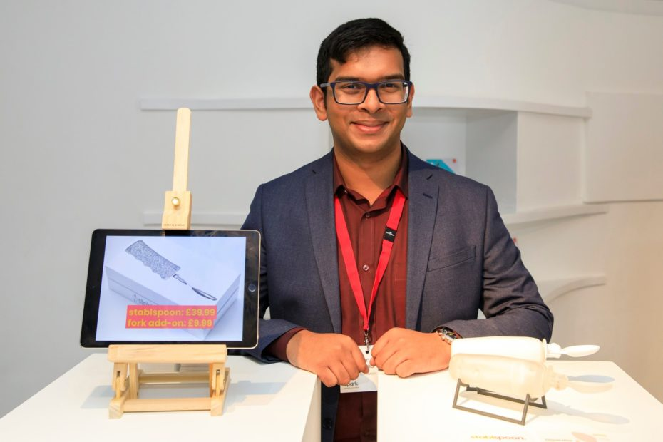 Photo of Hemal, inventor, pictured with prototype.